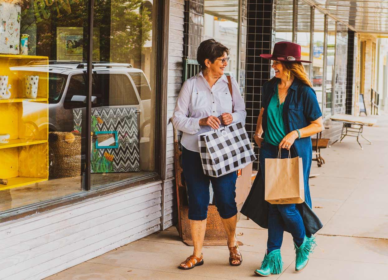 Showing two women shopping.