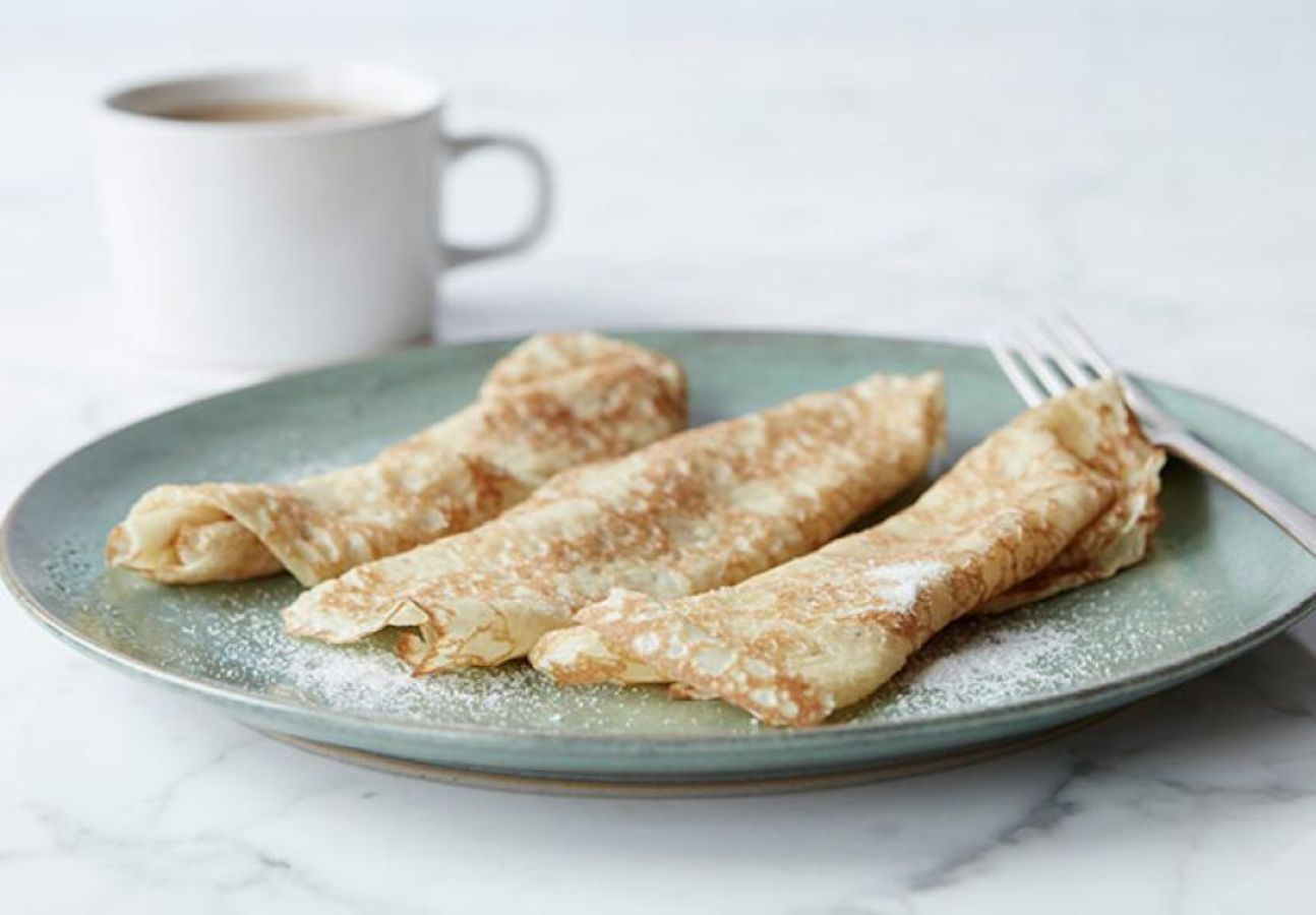 Showing a plate of crepes.